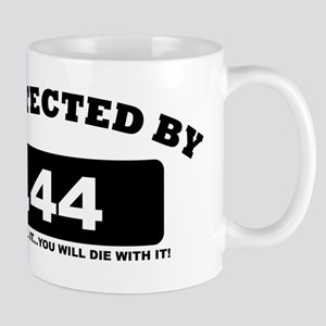 property of protected by 44 b Mug